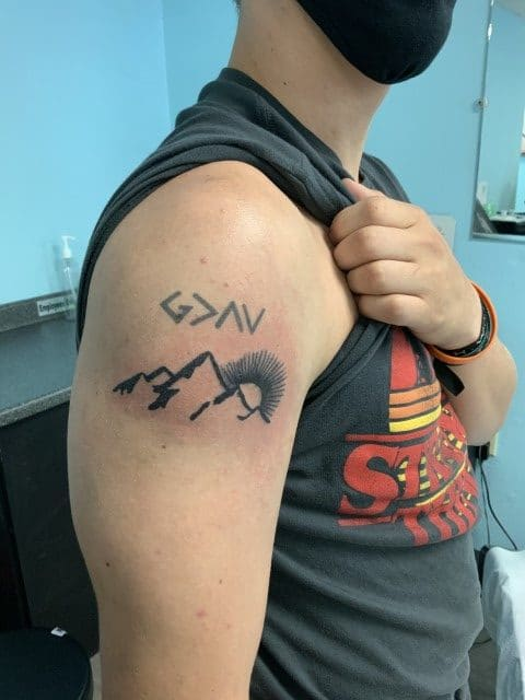 mountain tattoo on shoulder