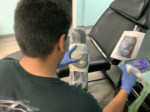 tattoo student practicing on fake skin