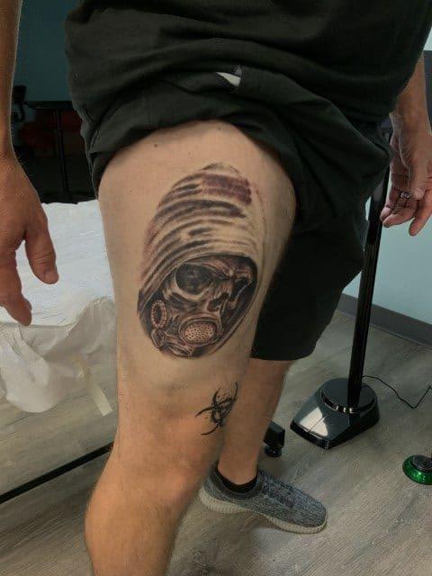 skull tattoo on upper thigh
