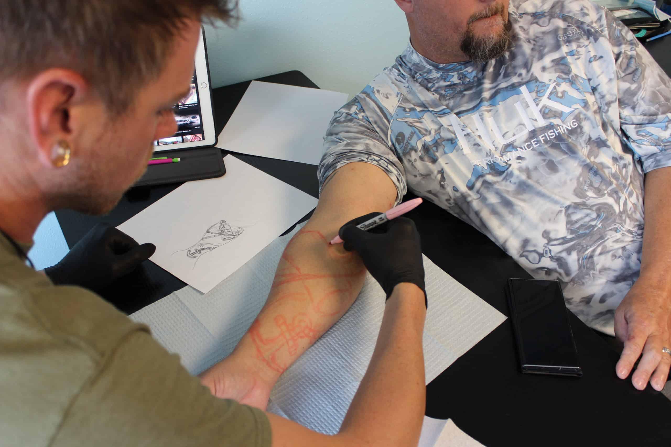 tattoo student outlining tattoo