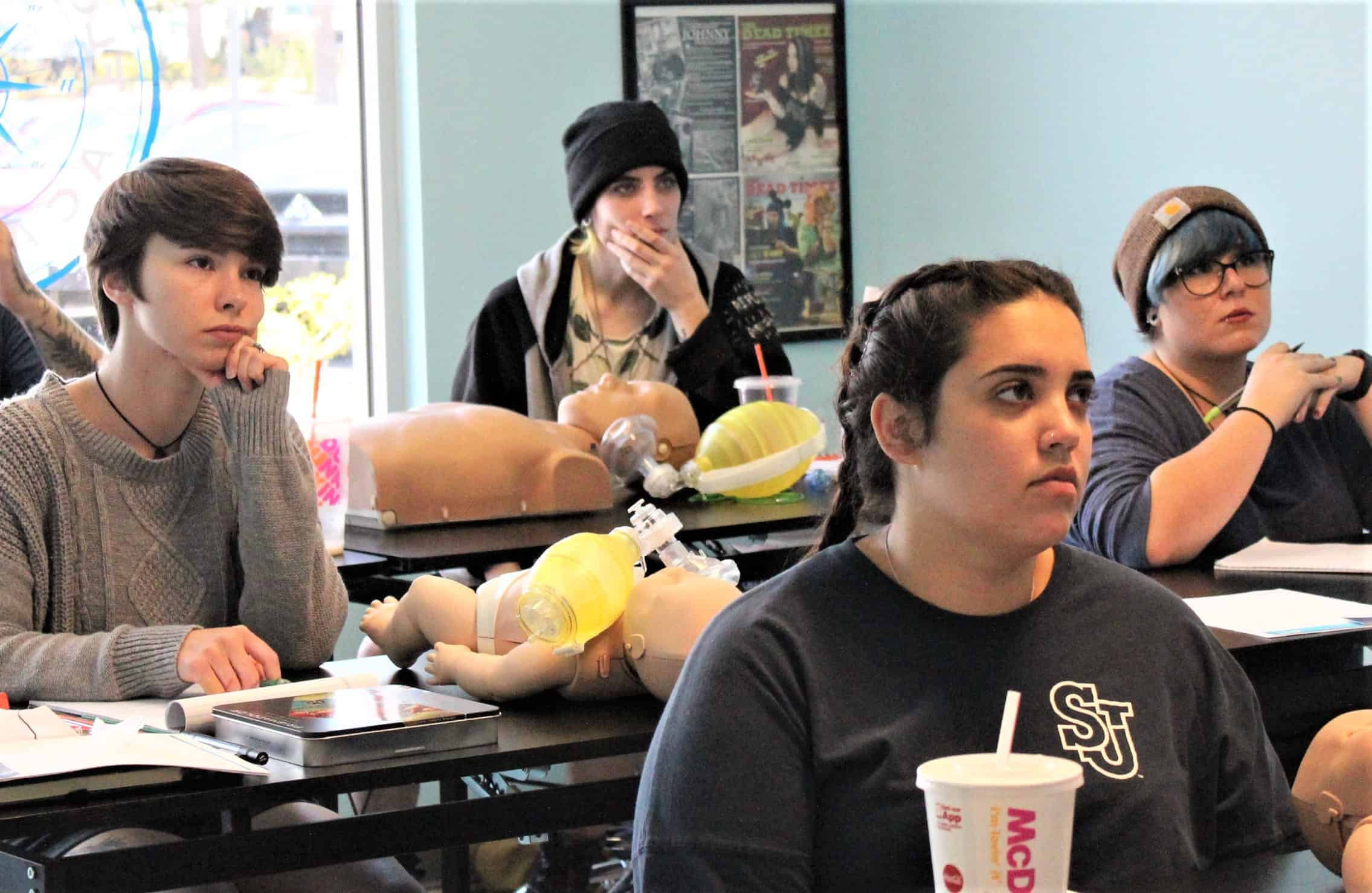 tattoo students learning cpr